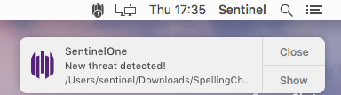 """A screenshot image of SentinelOne's pop up displaying """"new threat detected!"""" alert"""