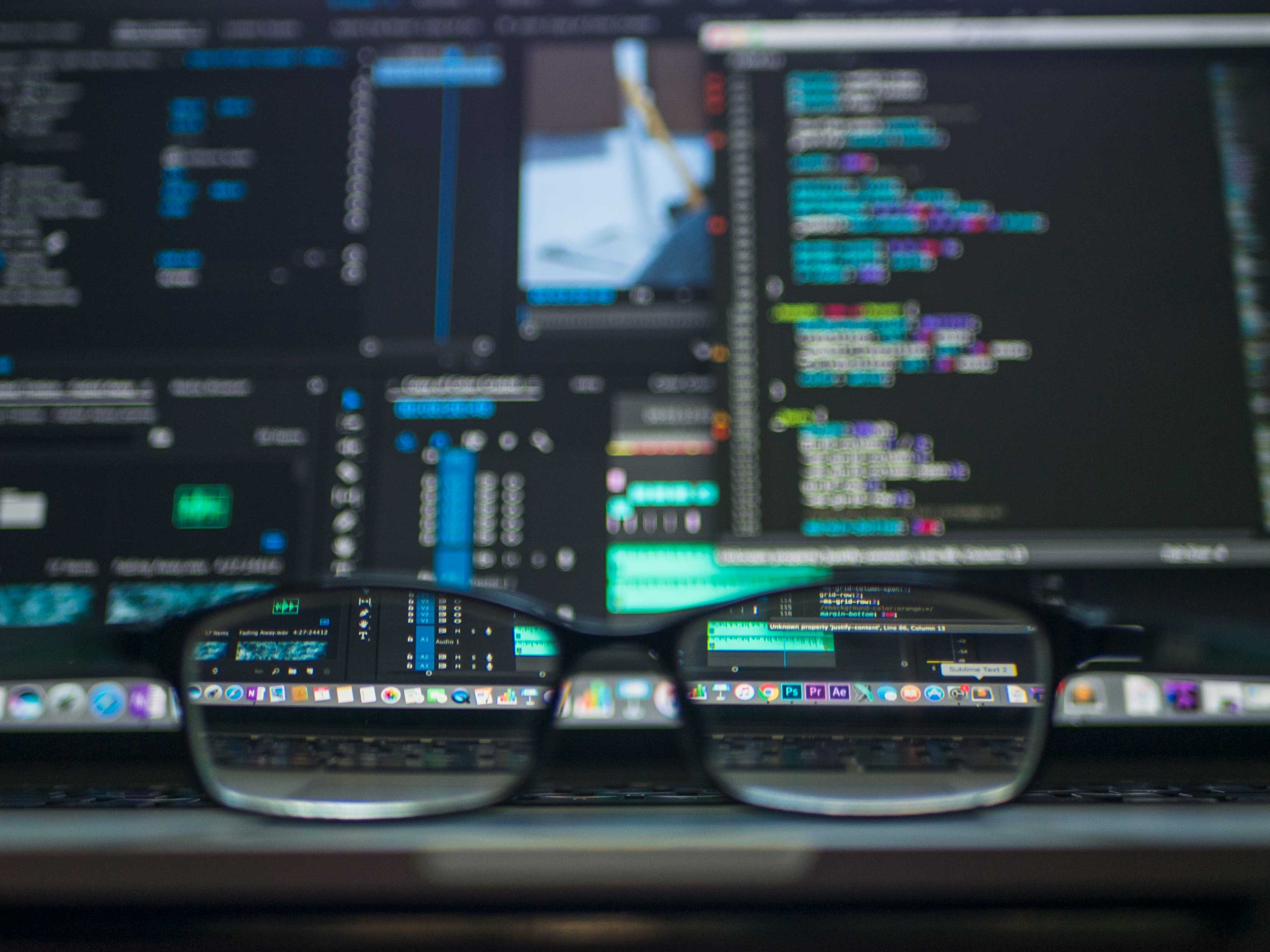 Prescription glasses in front of security source code used for artificial intelligence